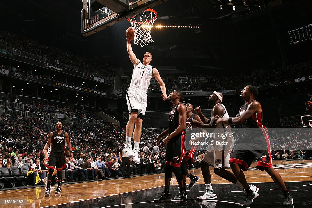 Mason Plumlee #1 of the Brooklyn Nets goes up to dunk during a preseason game against the Miami Heat at the Barclays Center on October 17, 2013 in the Brooklyn borough of New York City.