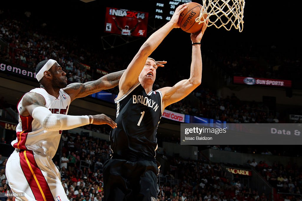 <a gi-track='captionPersonalityLinkClicked' href=/galleries/search?phrase=Mason+Plumlee&family=editorial&specificpeople=5792012 ng-click='$event.stopPropagation()'>Mason Plumlee</a> #1 of the Brooklyn Nets grabs a rebound against <a gi-track='captionPersonalityLinkClicked' href=/galleries/search?phrase=LeBron+James&family=editorial&specificpeople=201474 ng-click='$event.stopPropagation()'>LeBron James</a> #6 of the Miami Heat at the American Airlines Arena in Miami, Florida on April, 8 2014.