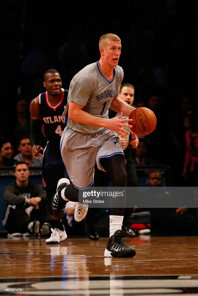 <a gi-track='captionPersonalityLinkClicked' href=/galleries/search?phrase=Mason+Plumlee&family=editorial&specificpeople=5792012 ng-click='$event.stopPropagation()'>Mason Plumlee</a> #1 of the Brooklyn Nets in action against the Atlanta Hawks at Barclays Center on April 11, 2014 in New York City.