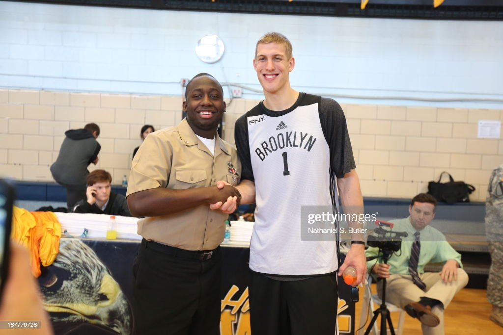 Mason Plumlee #1 of the Brooklyn Nets poses for a picture during a team event in celebration of Veterans Day at Ft. Hamilton, Brooklyn on November 11, 2013 in the Brooklyn borough of New York City.