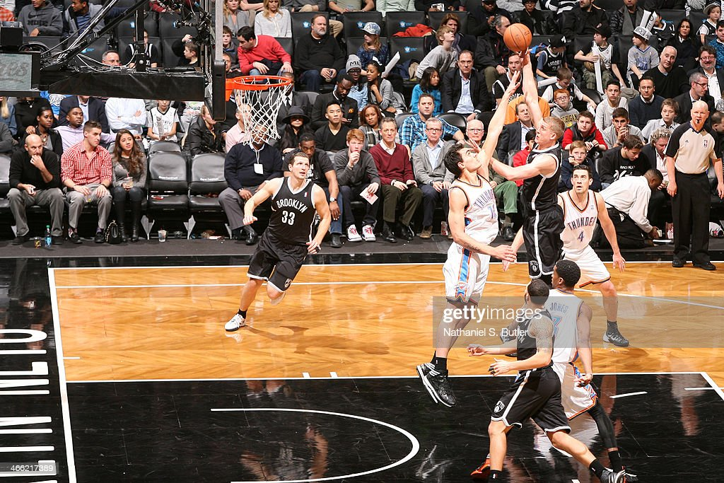 <a gi-track='captionPersonalityLinkClicked' href=/galleries/search?phrase=Mason+Plumlee&family=editorial&specificpeople=5792012 ng-click='$event.stopPropagation()'>Mason Plumlee</a> #1 of the Brooklyn Nets shoots against Steven Adams #12 of the Oklahoma City Thunder at the Barclays Center on January 31, 2014 in the Brooklyn borough of New York City.
