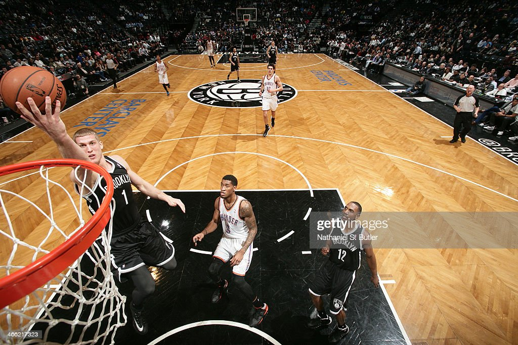 <a gi-track='captionPersonalityLinkClicked' href=/galleries/search?phrase=Mason+Plumlee&family=editorial&specificpeople=5792012 ng-click='$event.stopPropagation()'>Mason Plumlee</a> #1 of the Brooklyn Nets shoots against the Oklahoma Thunder at the Barclays Center on January 31, 2014 in the Brooklyn borough of New York City.
