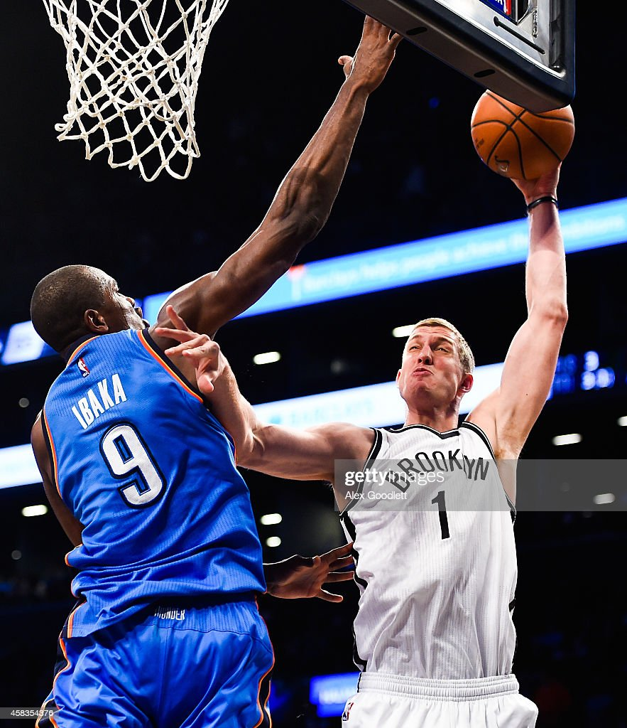 Mason Plumlee of the Brooklyn Nets shoots over Serge Ibaka of the Oklahoma City Thunder in the second half at the Barclays Center on November 3 2014...
