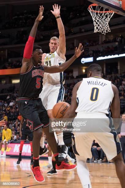 Mason Plumlee of the Denver Nuggets defends Bobby Portis of the Chicago Bulls at Pepsi Center on November 30 2017 in Denver Colorado