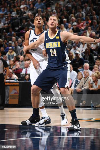 Mason Plumlee of the Denver Nuggets plays defense against Thabo Sefolosha of the Utah Jazz during the game on October 18 2017 at vivintSmartHome...
