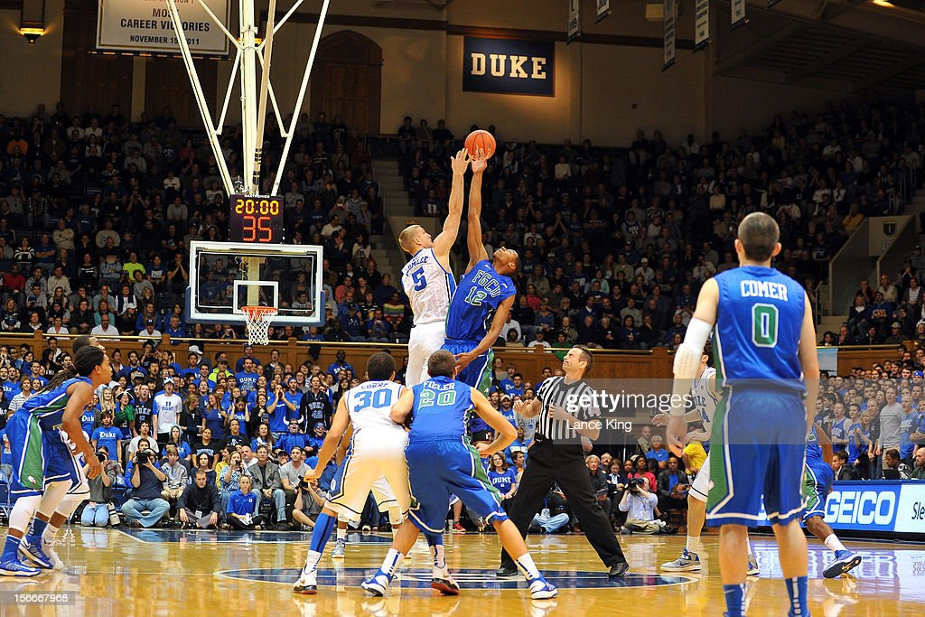<a gi-track='captionPersonalityLinkClicked' href=/galleries/search?phrase=Mason+Plumlee&family=editorial&specificpeople=5792012 ng-click='$event.stopPropagation()'>Mason Plumlee</a> #5 of the Duke Blue Devils and Eric McKnight #12 of the Florida Gulf Coast Eagles jump for the opening tip at Cameron Indoor Stadium on November 18, 2012 in Durham, North Carolina.