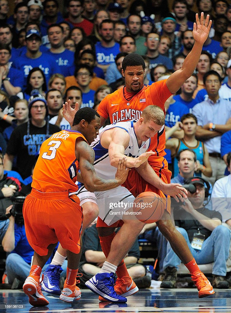 <a gi-track='captionPersonalityLinkClicked' href=/galleries/search?phrase=Mason+Plumlee&family=editorial&specificpeople=5792012 ng-click='$event.stopPropagation()'>Mason Plumlee</a> #5 of the Duke Blue Devils battles for a loose ball with Adonis Filer #3 and Devin Booker #31 of the Clemson Tigers during play at Cameron Indoor Stadium on January 8, 2013 in Durham, North Carolina.