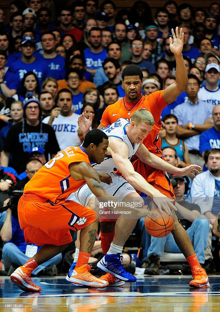 Mason Plumlee #5 of the Duke Blue Devils battles for a loose ball with Adonis Filer #3 and Devin Booker #31 of the Clemson Tigers during play at Cameron Indoor Stadium on January 8, 2013 in Durham, North Carolina.