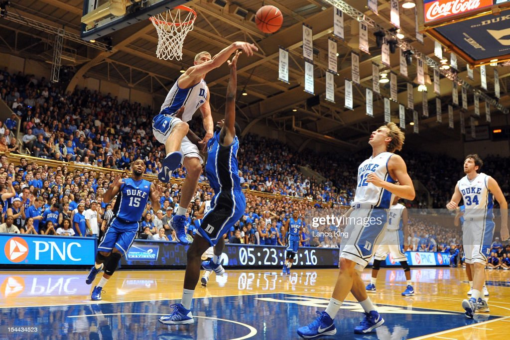 <a gi-track='captionPersonalityLinkClicked' href=/galleries/search?phrase=Mason+Plumlee&family=editorial&specificpeople=5792012 ng-click='$event.stopPropagation()'>Mason Plumlee</a> #5 of the Duke Blue Devils blocks a shot by Amile Jefferson #21 during Countdown to Craziness at Cameron Indoor Stadium on October 19, 2012 in Durham, North Carolina.