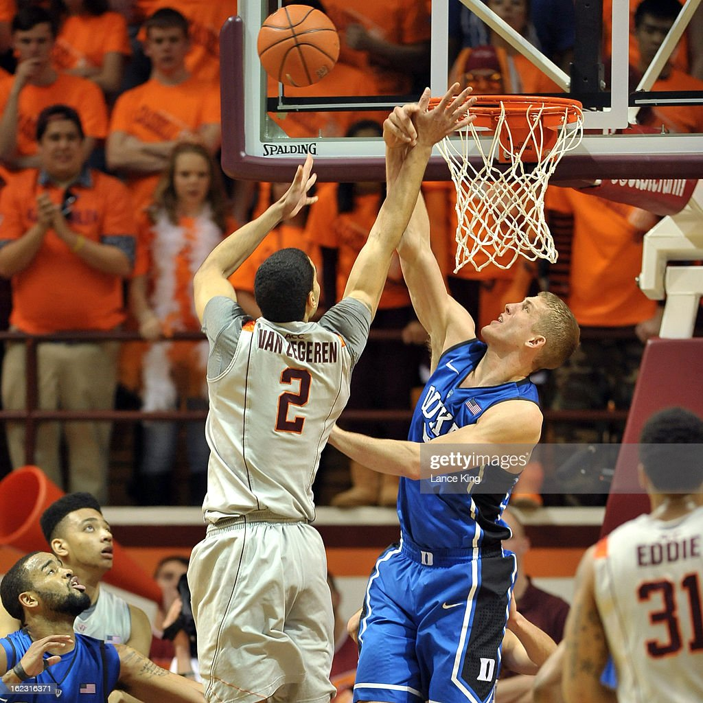 Mason Plumlee #5 of the Duke Blue Devils blocks a shot by Joey Van Zegere #2 of the Virginia Tech Hokies at Cassell Coliseum on February 21, 2013 in Blacksburg, Virginia.