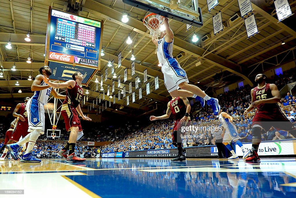 Mason Plumlee #5 of the Duke Blue Devils connects on an alley-oop dunk against the Santa Clara Broncos at Cameron Indoor Stadium on December 29, 2012 in Durham, North Carolina.
