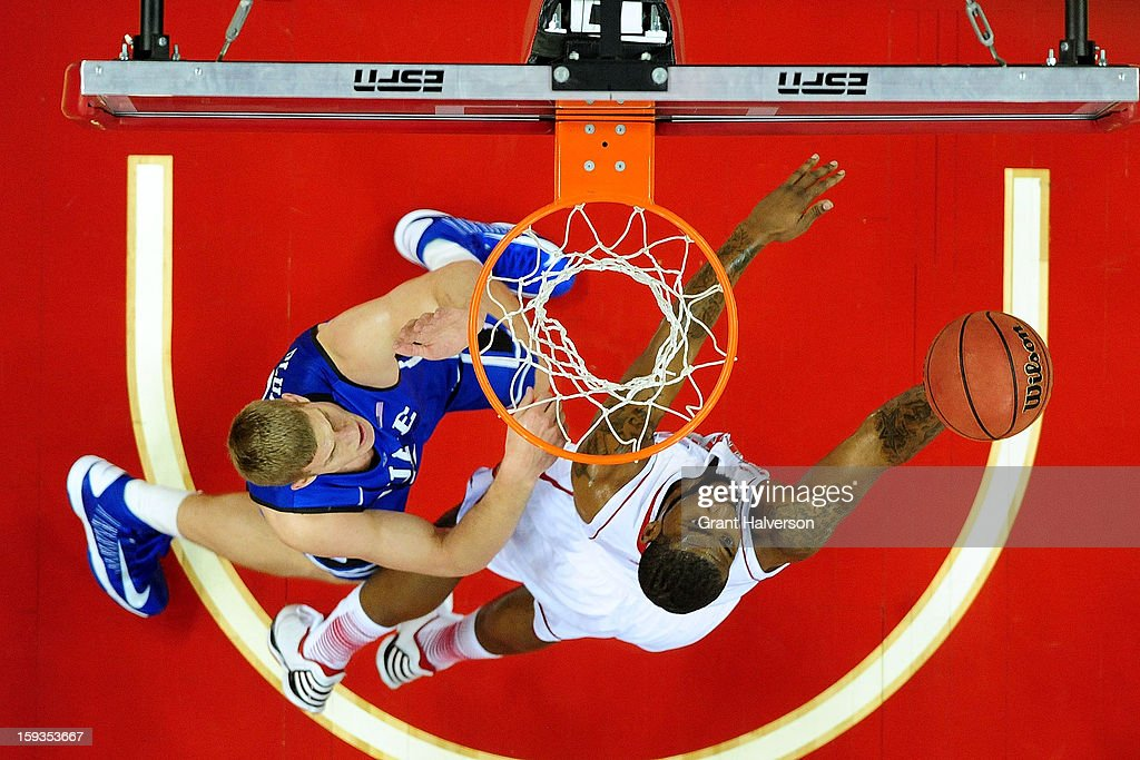 Mason Plumlee of the Duke Blue Devils defends a shot by Richard Howell of the North Carolina State Wolfpack during play at PNC Arena on January 12...