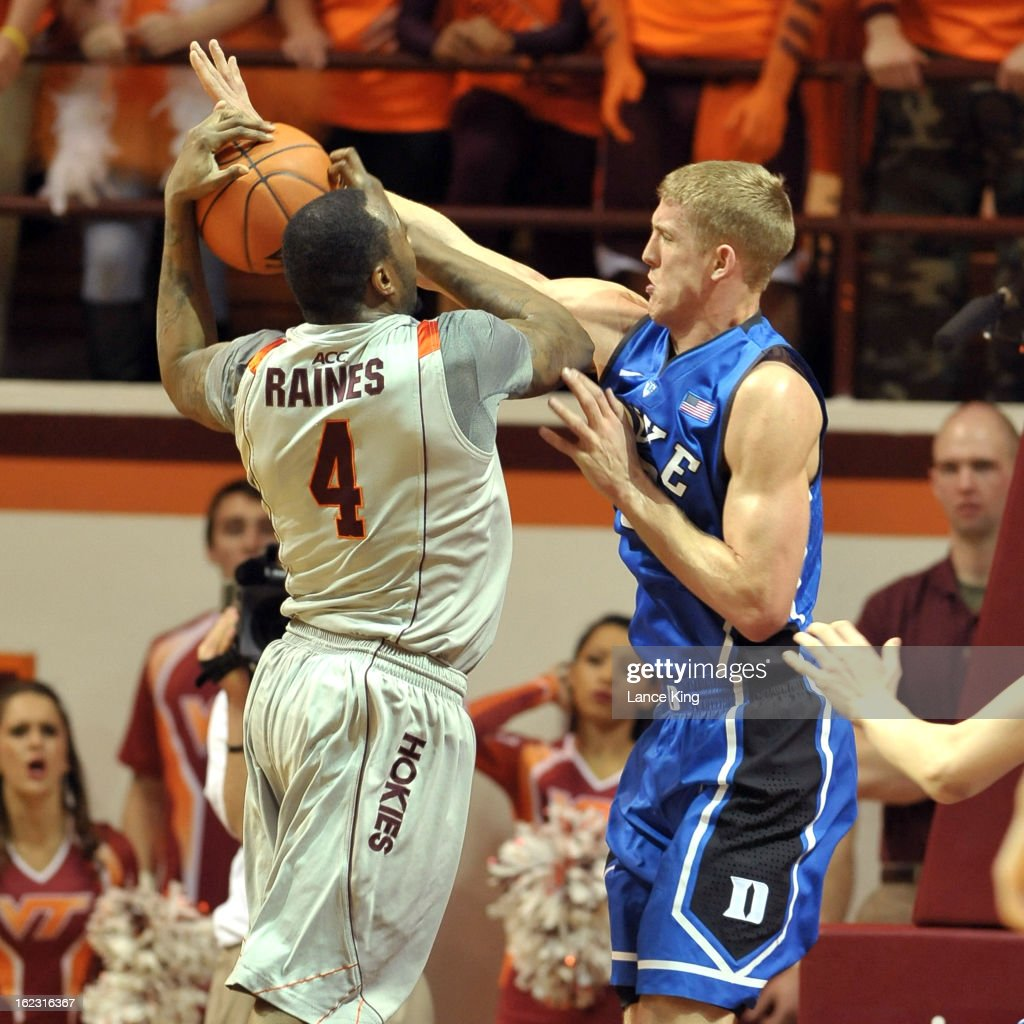 Mason Plumlee #5 of the Duke Blue Devils defends Cadarian Raines #4 of the Virginia Tech Hokies at Cassell Coliseum on February 21, 2013 in Blacksburg, Virginia.