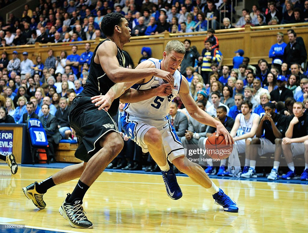 Mason Plumlee #5 of the Duke Blue Devils drives the baseline against Devin Thomas #2 of the Wake Forest Demon Deacons during play at Cameron Indoor Stadium on January 5, 2013 in Durham, North Carolina. Duke won 80-62.