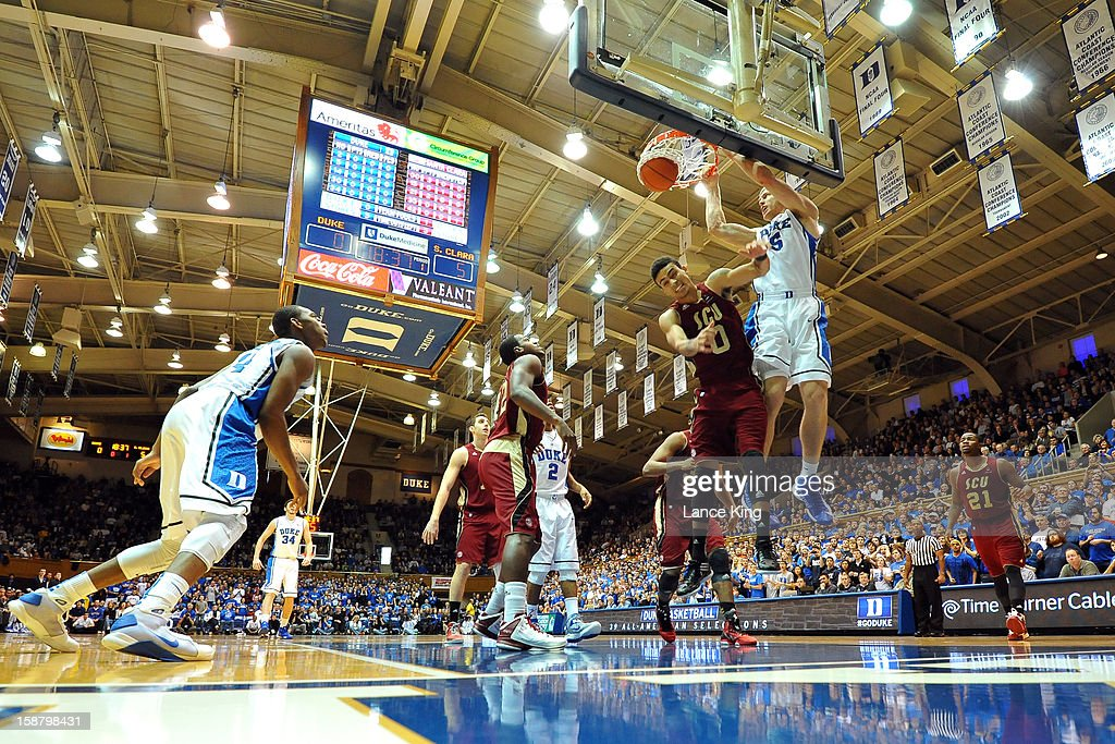 Mason Plumlee #5 of the Duke Blue Devils dunks against Evan Roquemore #0 of the Santa Clara Broncos at Cameron Indoor Stadium on December 29, 2012 in Durham, North Carolina.