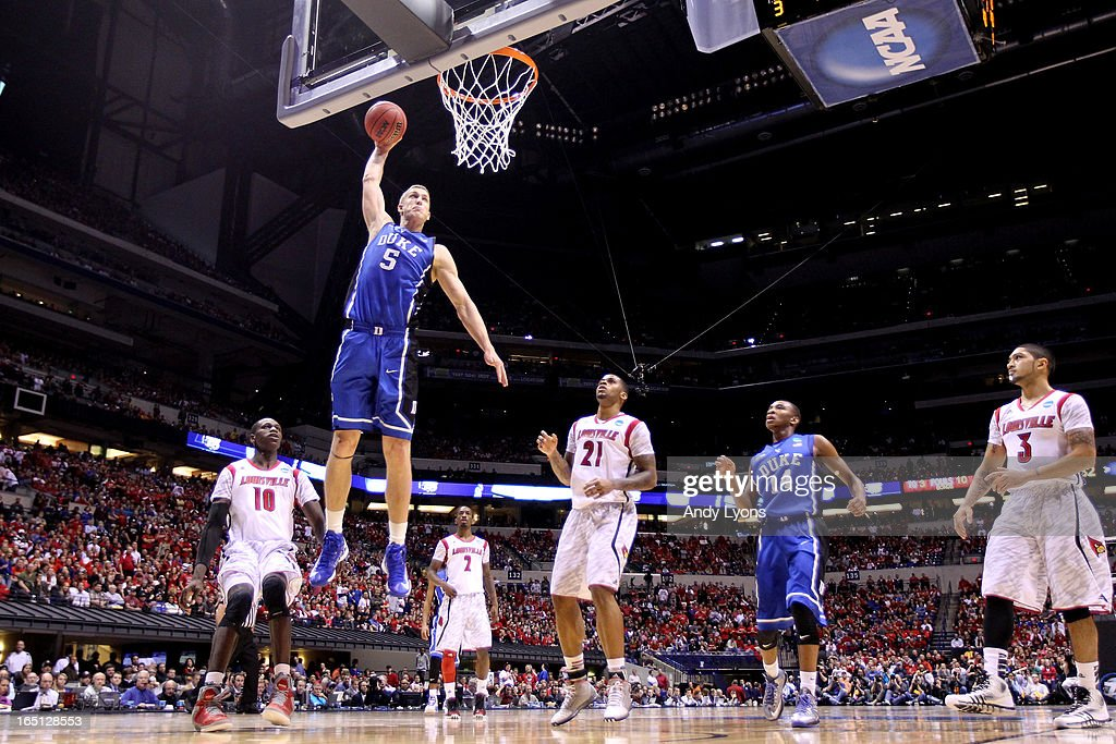 <a gi-track='captionPersonalityLinkClicked' href=/galleries/search?phrase=Mason+Plumlee&family=editorial&specificpeople=5792012 ng-click='$event.stopPropagation()'>Mason Plumlee</a> #5 of the Duke Blue Devils dunks against the Louisville Cardinals during the Midwest Regional Final round of the 2013 NCAA Men's Basketball Tournament at Lucas Oil Stadium on March 31, 2013 in Indianapolis, Indiana.