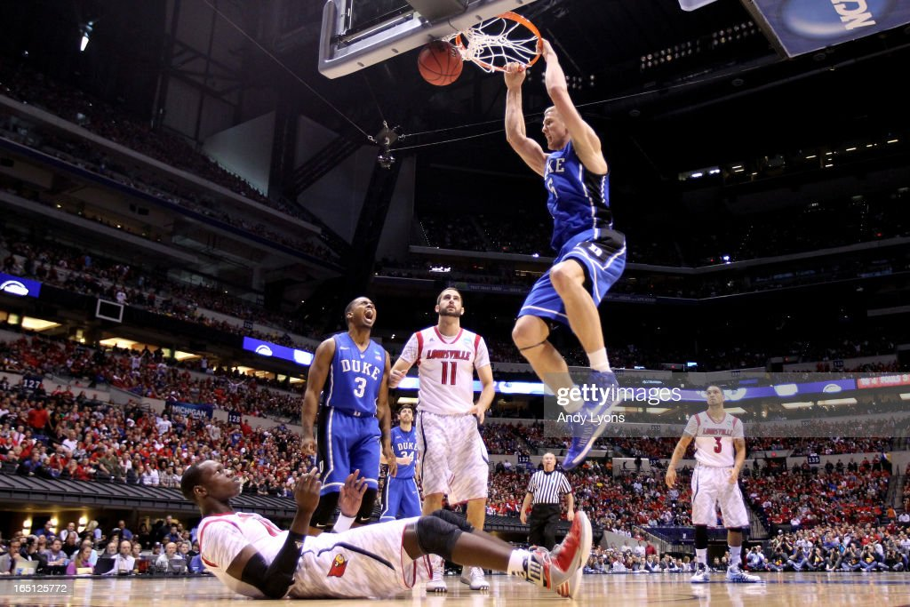 <a gi-track='captionPersonalityLinkClicked' href=/galleries/search?phrase=Mason+Plumlee&family=editorial&specificpeople=5792012 ng-click='$event.stopPropagation()'>Mason Plumlee</a> #5 of the Duke Blue Devils dunks in the second half over <a gi-track='captionPersonalityLinkClicked' href=/galleries/search?phrase=Gorgui+Dieng&family=editorial&specificpeople=7363274 ng-click='$event.stopPropagation()'>Gorgui Dieng</a> #10 of the Louisville Cardinals during the Midwest Regional Final round of the 2013 NCAA Men's Basketball Tournament at Lucas Oil Stadium on March 31, 2013 in Indianapolis, Indiana.