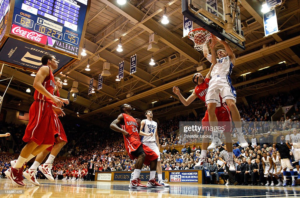 Mason Plumlee #5 of the Duke Blue Devils dunks on Clint Mann #40 of the Davidson Wildcats during their game at Cameron Indoor Stadium on November 18, 2011 in Durham, North Carolina.