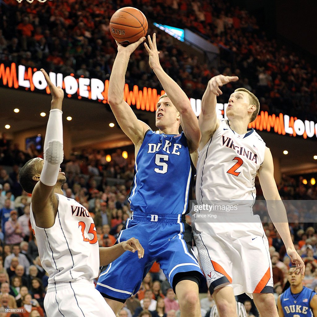 <a gi-track='captionPersonalityLinkClicked' href=/galleries/search?phrase=Mason+Plumlee&family=editorial&specificpeople=5792012 ng-click='$event.stopPropagation()'>Mason Plumlee</a> #5 of the Duke Blue Devils goes to the hoop against Akil Mitchell #25 and Paul Jesperson #2 of the Virginia Cavaliers at John Paul Jones Arena on February 28, 2013 in Charlottesville, Virginia.