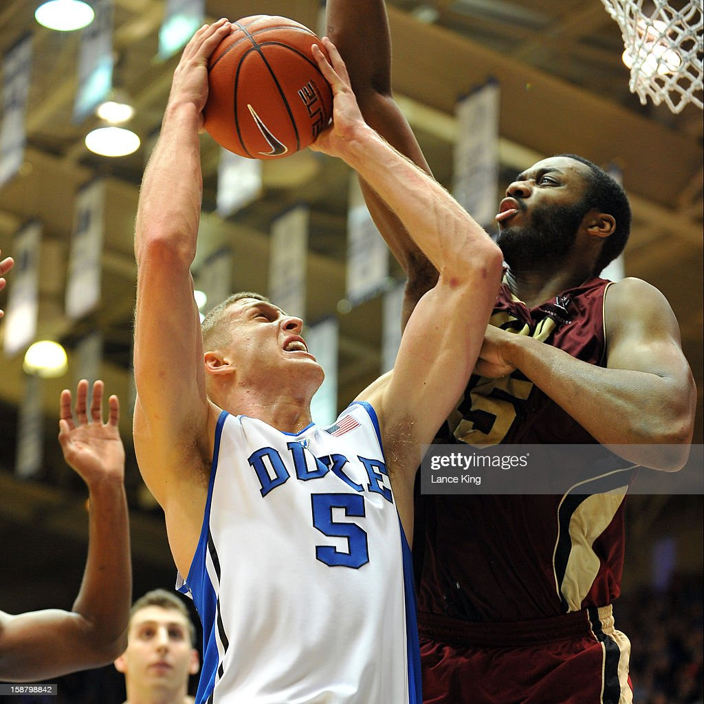 Mason Plumlee #5 of the Duke Blue Devils goes to the hoop against Robert Garrett #35 of the Santa Clara Broncos at Cameron Indoor Stadium on December 29, 2012 in Durham, North Carolina.