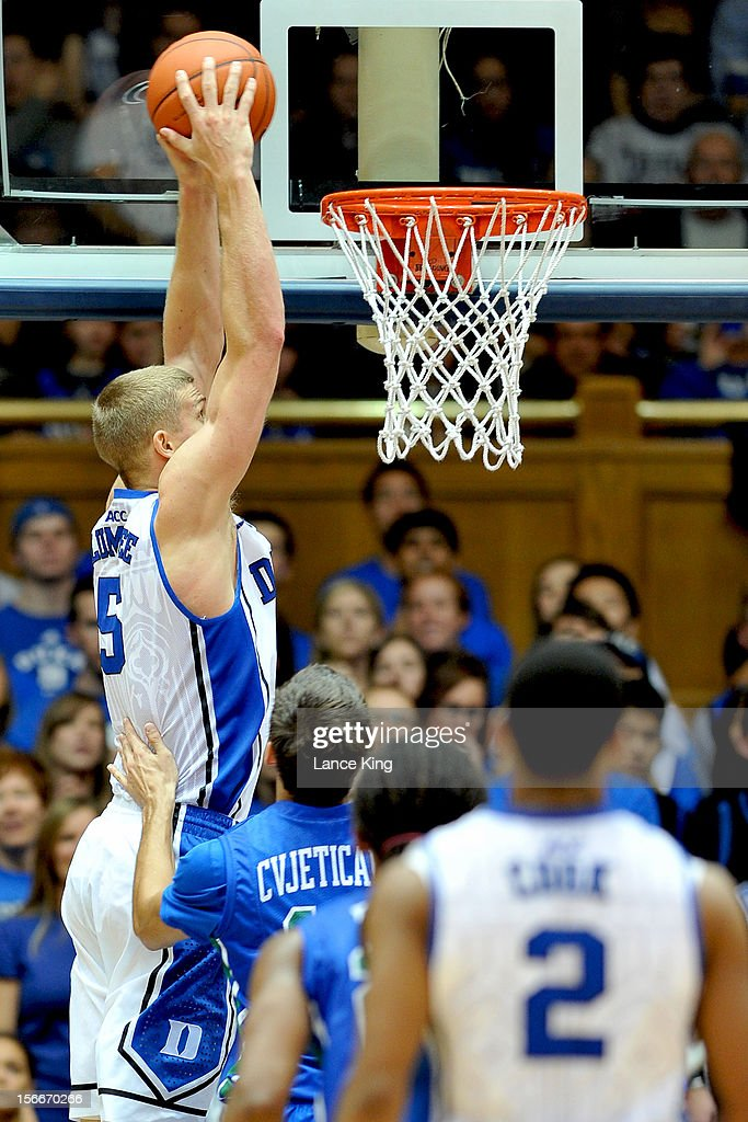 Mason Plumlee #5 of the Duke Blue Devils goes up for a dunk against the Florida Gulf Coast Eagles at Cameron Indoor Stadium on November 18, 2012 in Durham, North Carolina. Duke defeated Florida Gulf Coast 88-67.