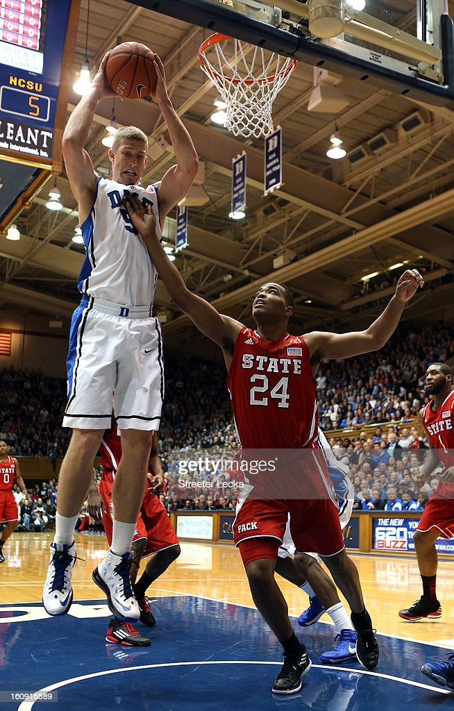 Mason Plumlee #5 of the Duke Blue Devils grabs a rebound over T.J. Warren #24 of the North Carolina State Wolfpack during their game at Cameron Indoor Stadium on February 7, 2013 in Durham, North Carolina.