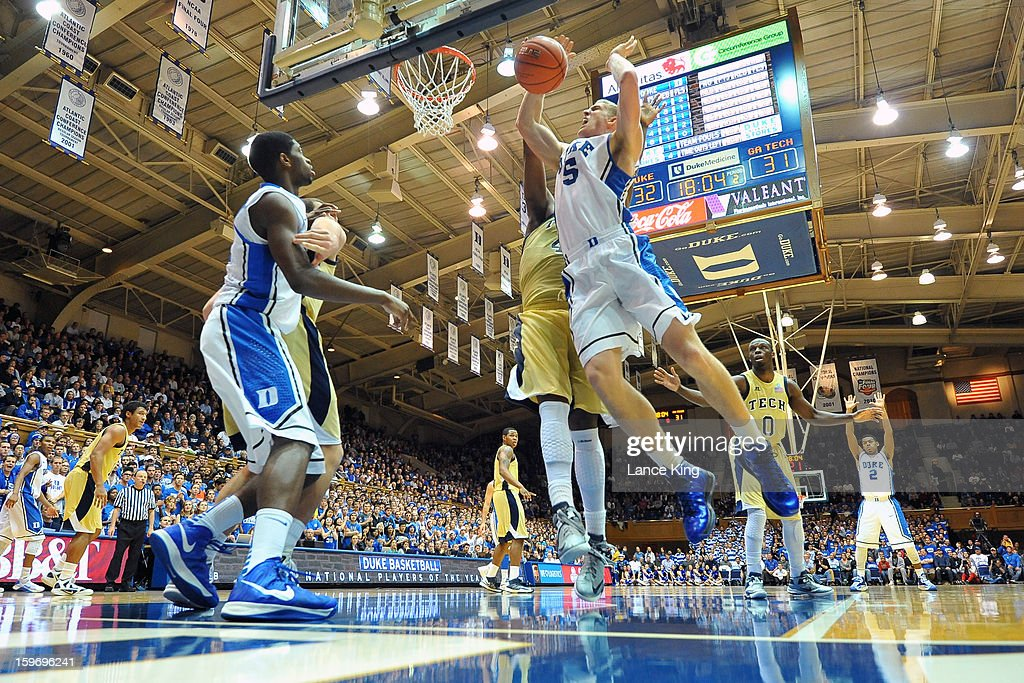 Mason Plumlee #5 of the Duke Blue Devils is fouled by Robert Carter, Jr. #4 of the Georgia Tech Yellow Jackets at Cameron Indoor Stadium on January 17, 2013 in Durham, North Carolina. Duke defeated Georgia Tech 73-57.