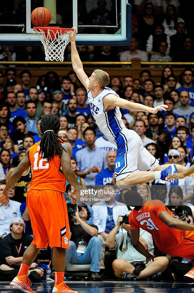 <a gi-track='captionPersonalityLinkClicked' href=/galleries/search?phrase=Mason+Plumlee&family=editorial&specificpeople=5792012 ng-click='$event.stopPropagation()'>Mason Plumlee</a> #5 of the Duke Blue Devils misses a dunk as he leaps over Devin Booker #31 of the Clemson Tigers during play at Cameron Indoor Stadium on January 8, 2013 in Durham, North Carolina.