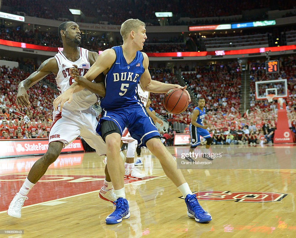 Mason Plumlee #5 of the Duke Blue Devils posts up against C.J. Leslie #5 of the North Carolina State Wolfpack during play at PNC Arena on January 12, 2013 in Raleigh, North Carolina. North Carolina State won 84-76.