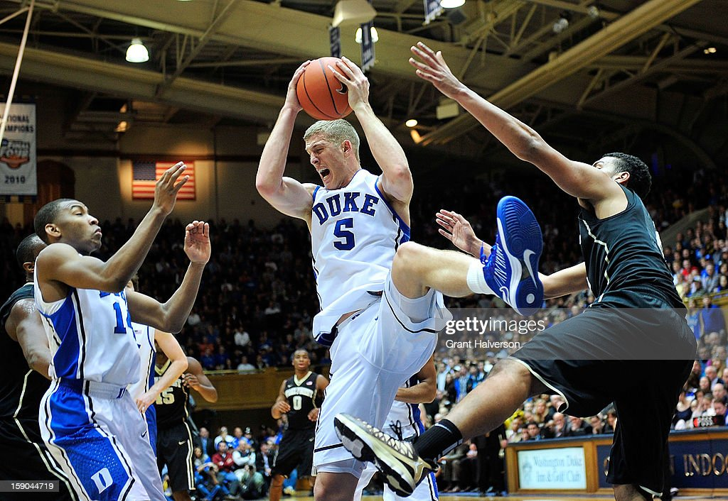 Mason Plumlee #5 of the Duke Blue Devils pulls down a rebound against the Wake Forest Demon Deacons during play at Cameron Indoor Stadium on January 5, 2013 in Durham, North Carolina. Duke won 80-62.