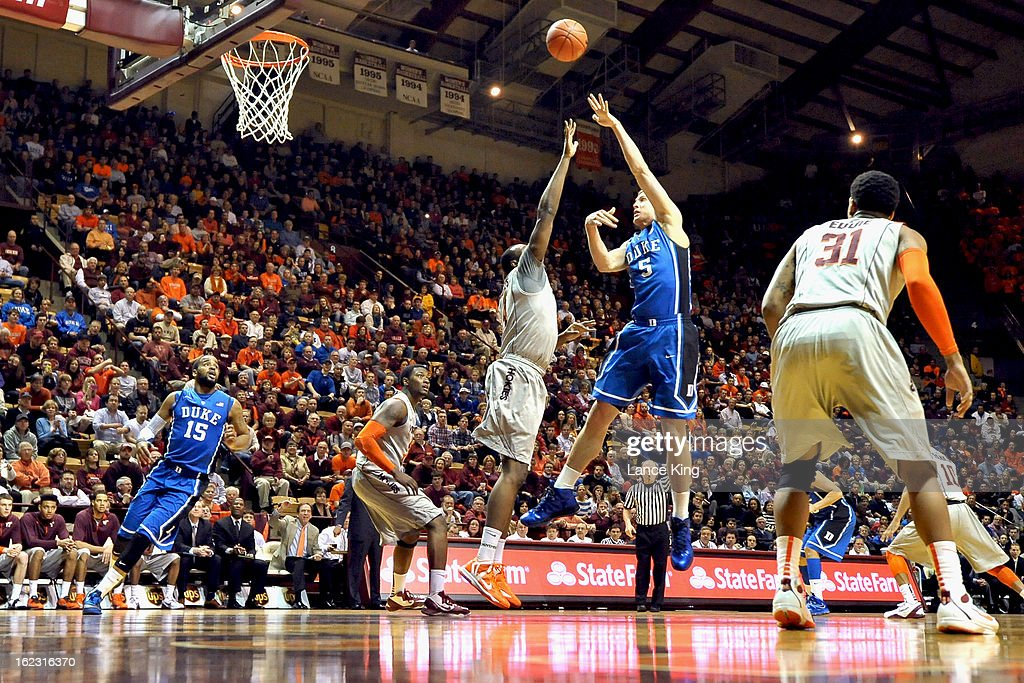 Mason Plumlee #5 of the Duke Blue Devils puts up a shot against Cadarian Raines #4 of the Virginia Tech Hokies at Cassell Coliseum on February 21, 2013 in Blacksburg, Virginia.