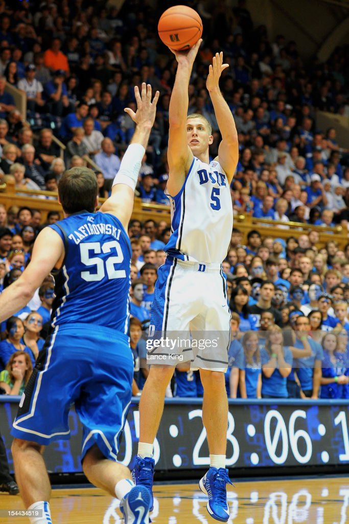 <a gi-track='captionPersonalityLinkClicked' href=/galleries/search?phrase=Mason+Plumlee&family=editorial&specificpeople=5792012 ng-click='$event.stopPropagation()'>Mason Plumlee</a> #5 of the Duke Blue Devils puts up a shot during Countdown to Craziness at Cameron Indoor Stadium on October 19, 2012 in Durham, North Carolina.