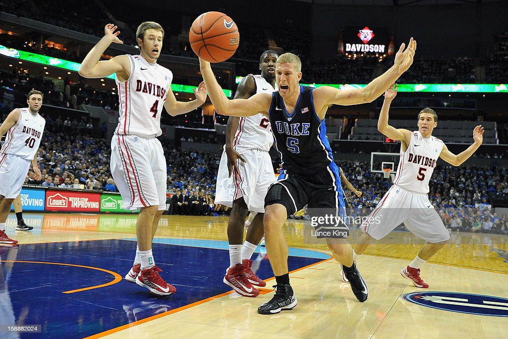 Mason Plumlee #5 of the Duke Blue Devils reacts as the ball goes out of bounds against the Davidson Wildcats at Time Warner Cable Arena on January 2, 2013 in Charlotte, North Carolina.