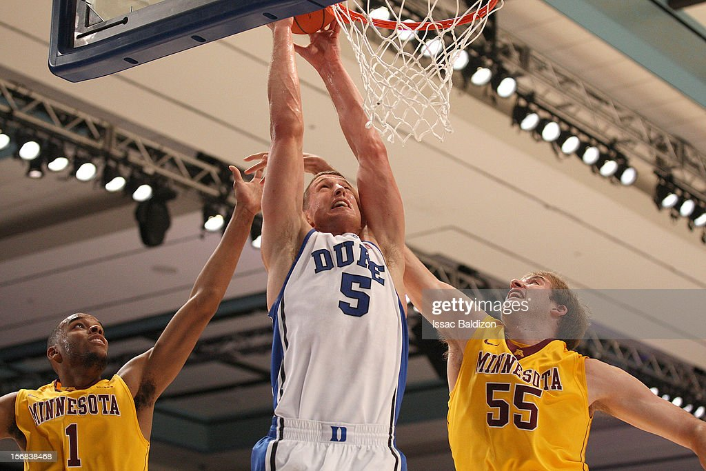 Mason Plumlee #5 of the Duke Blue Devils shoots against Elliot Eliason #55 of the Minnesota Gophers during the Battle 4 Atlantis tournament at Atlantis Resort on November 22, 2012 in Nassau, Paradise Island, Bahamas.
