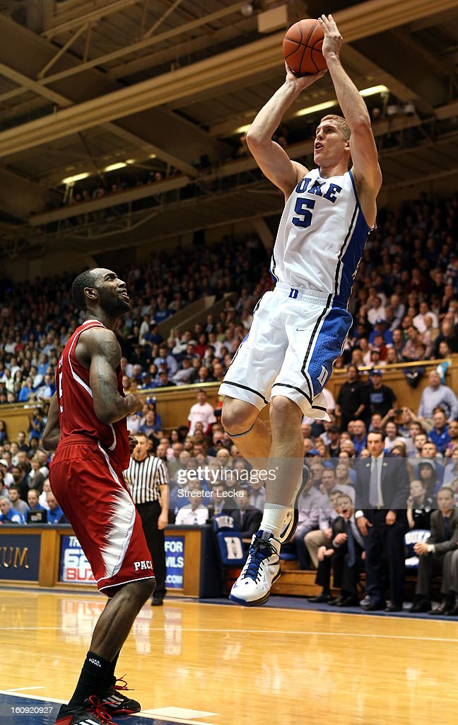 <a gi-track='captionPersonalityLinkClicked' href=/galleries/search?phrase=Mason+Plumlee&family=editorial&specificpeople=5792012 ng-click='$event.stopPropagation()'>Mason Plumlee</a> #5 of the Duke Blue Devils shoots over <a gi-track='captionPersonalityLinkClicked' href=/galleries/search?phrase=C.J.+Leslie&family=editorial&specificpeople=6902920 ng-click='$event.stopPropagation()'>C.J. Leslie</a> #5 of the North Carolina State Wolfpack during their game at Cameron Indoor Stadium on February 7, 2013 in Durham, North Carolina.
