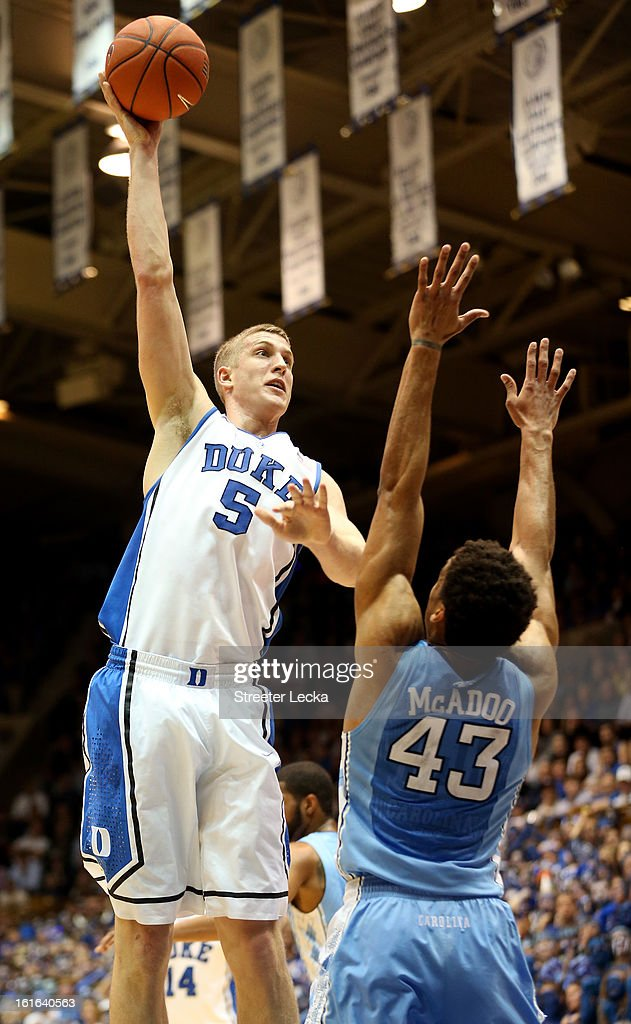 Mason Plumlee #5 of the Duke Blue Devils shoots over James Michael McAdoo #43 of the North Carolina Tar Heels during their game at Cameron Indoor Stadium on February 13, 2013 in Durham, North Carolina.