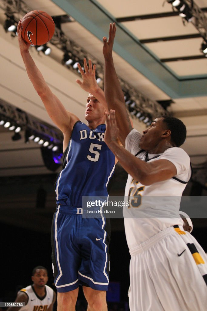 Mason Plumlee #5 of the Duke Blue Devils shoots over Jarred Reddic #15 of the VCU Rams during the Battle 4 Atlantis tournament at Atlantis Resort November 23, 2012 in Nassau, Paradise Island, Bahamas.