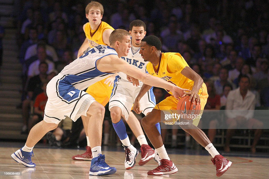 Mason Plumlee #5 of the Duke Blue Devils steals the ball from Austin Hollins #20 of the Minnesota Gophers during the Battle 4 Atlantis tournament at Atlantis Resort on November 22, 2012 in Nassau, Paradise Island, Bahamas.