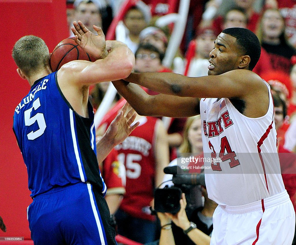 Mason Plumlee #5 of the Duke Blue Devils ties up with T.J. Warren #24 of the North Carolina State Wolfpack as they battle for a rebound during play at PNC Arena on January 12, 2013 in Raleigh, North Carolina.