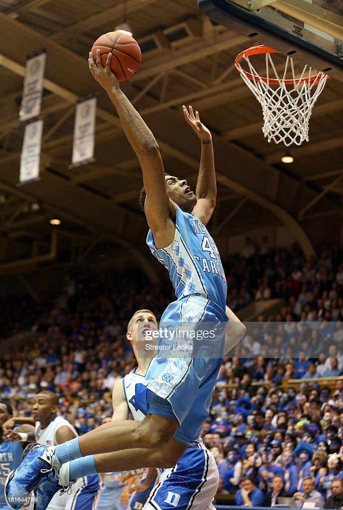 Mason Plumlee #5 of the Duke Blue Devils watches as James Michael McAdoo #43 of the North Carolina Tar Heels drives to the basket during their game at Cameron Indoor Stadium on February 13, 2013 in Durham, North Carolina.