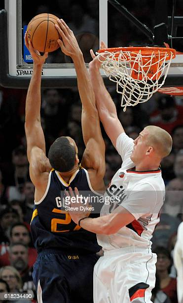 Mason Plumlee of the Portland Trail Blazers blocks the shot of Rudy Gobert of the Utah Jazz in the first quarter of an NBA game at the Moda Center on...