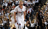 Mason Plumlee of the Portland Trail Blazers celebrates after his teammate scores in the first quarter of Game Six of the Western Conference...