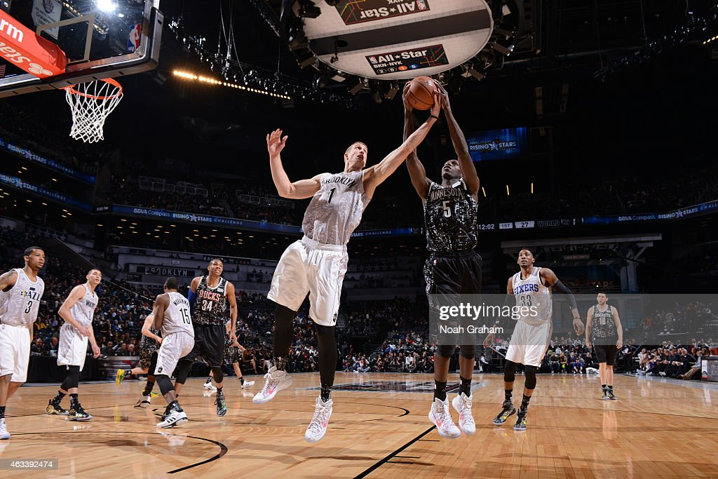 <a gi-track='captionPersonalityLinkClicked' href=/galleries/search?phrase=Mason+Plumlee&family=editorial&specificpeople=5792012 ng-click='$event.stopPropagation()'>Mason Plumlee</a> #1 of the USA team rebounds against <a gi-track='captionPersonalityLinkClicked' href=/galleries/search?phrase=Gorgui+Dieng&family=editorial&specificpeople=7363274 ng-click='$event.stopPropagation()'>Gorgui Dieng</a> #5 of the World team in the 2015 BBVA Rising Stars Challenge on February 13, 2015 at Barclays Center in Brooklyn, New York.