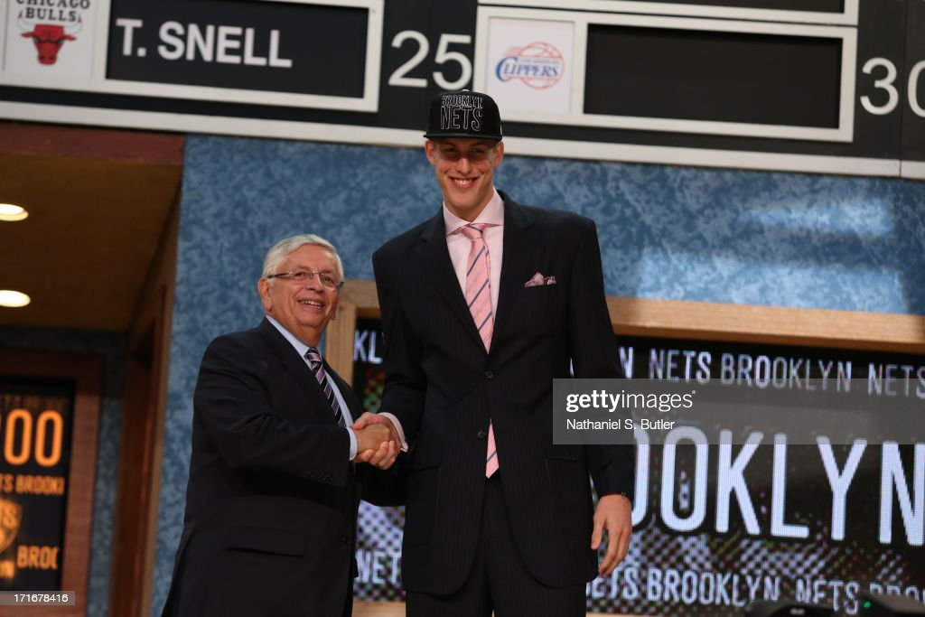 Mason Plumlee shakes hands with NBA Commissioner, David Stern after being selected number twenty two overall by the Brooklyn Nets during the 2013 NBA Draft on June 27, 2013 at Barclays Center in Brooklyn, New York.