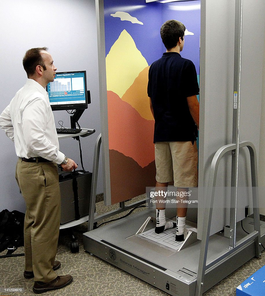Mason Pritcher, a high school athlete, goes through tests with Dr. Jacob Resch, left, who is conducting research on concussions in young athletes at the University of Texas Arlington on March 7, 2012.