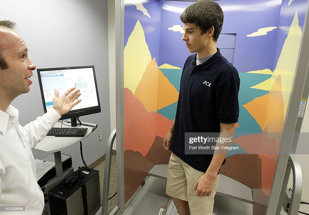 Mason Pritcher, a high school athlete, talks with Dr. Jacob Resch, left, who is conducting research on concussions in young athletes at the University of Texas Arlington on March 7, 2012.