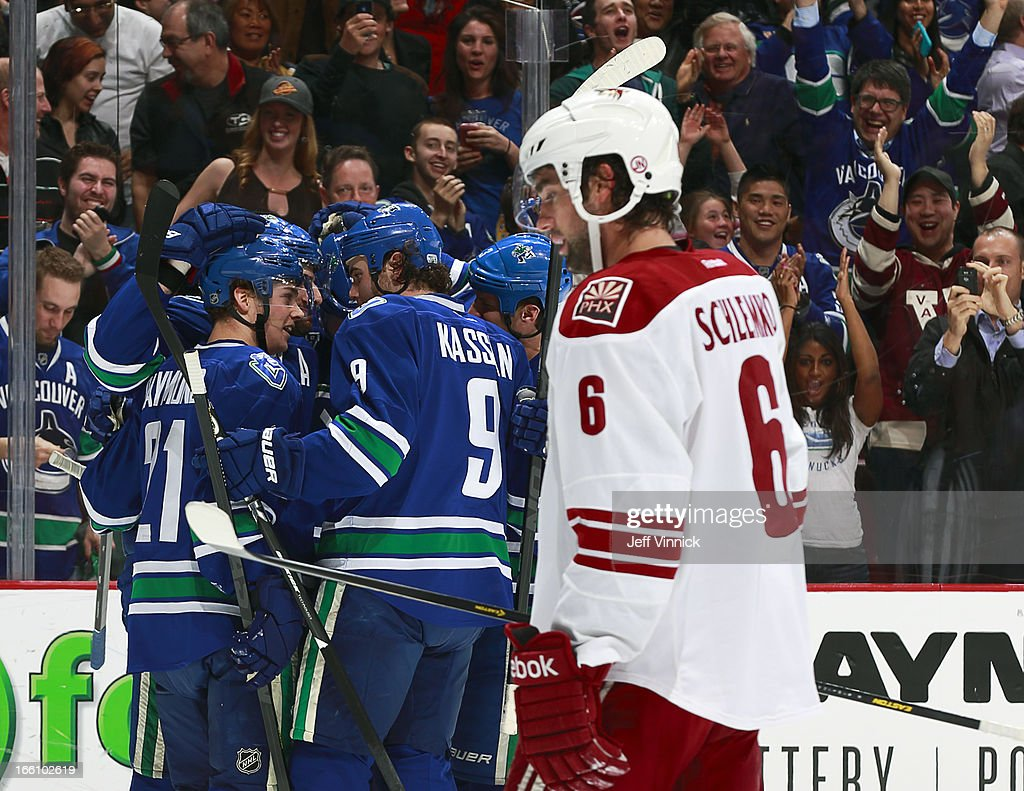 Mason Raymond #21 and Zack Kassian #9 of the Vancouver Canucks celebrate a goal with teammates while David Schlemko #6 of the Phoenix Coyotes skates away during an NHL game at Rogers Arena April 8, 2013 in Vancouver, British Columbia, Canada.
