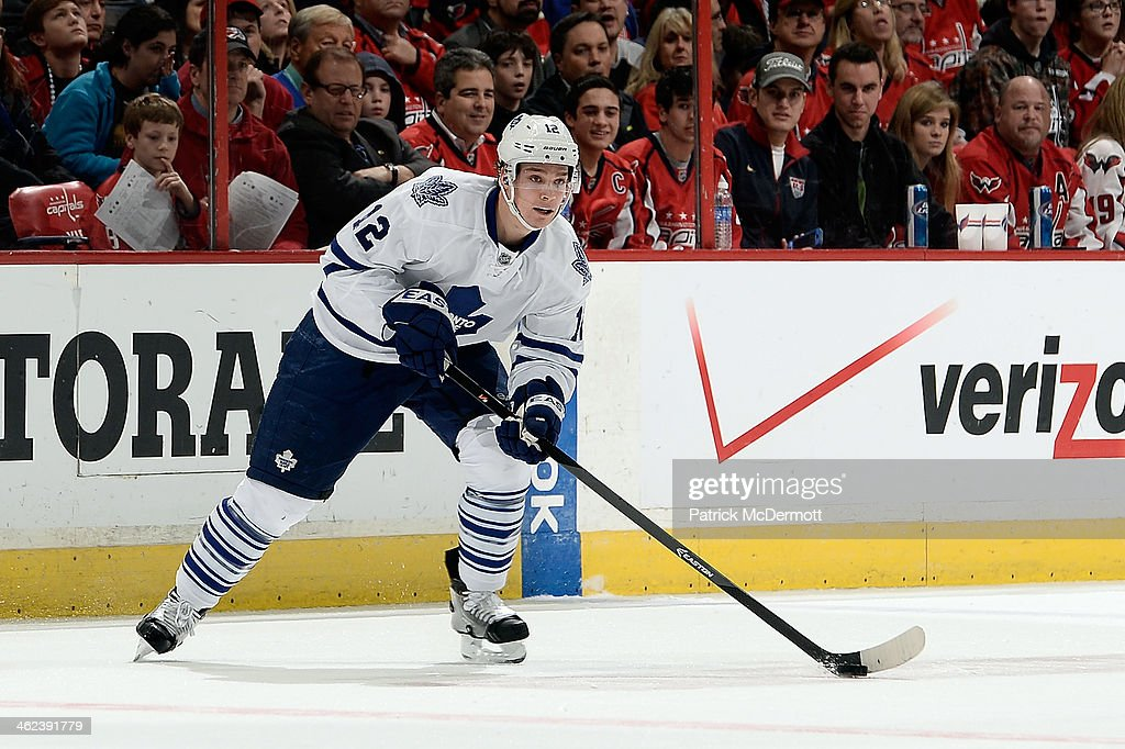 <a gi-track='captionPersonalityLinkClicked' href=/galleries/search?phrase=Mason+Raymond&family=editorial&specificpeople=4521385 ng-click='$event.stopPropagation()'>Mason Raymond</a> #12 of the Toronto Maple Leafs controls the puck in the second period during an NHL game against the Washington Capitals at Verizon Center on January 10, 2014 in Washington, DC.