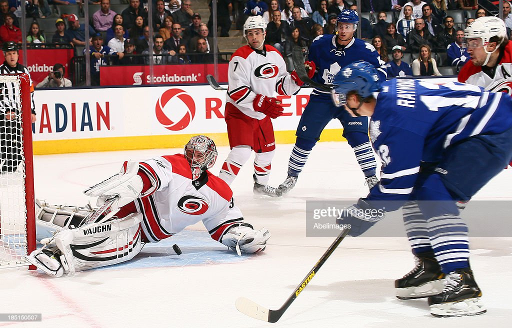 <a gi-track='captionPersonalityLinkClicked' href=/galleries/search?phrase=Mason+Raymond&family=editorial&specificpeople=4521385 ng-click='$event.stopPropagation()'>Mason Raymond</a> #12 of the Toronto Maple Leafs gets stopped by <a gi-track='captionPersonalityLinkClicked' href=/galleries/search?phrase=Cam+Ward&family=editorial&specificpeople=453216 ng-click='$event.stopPropagation()'>Cam Ward</a> #30 of the Carolina Hurricanes during NHL action at the Air Canada Centre October 17, 2013 in Toronto, Ontario, Canada.
