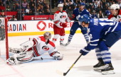 Mason Raymond of the Toronto Maple Leafs gets stopped by Cam Ward of the Carolina Hurricanes during NHL action at the Air Canada Centre October 17...